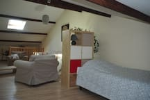The Studio: sleeping area with 2 twin beds with tv lounge (upstairs)