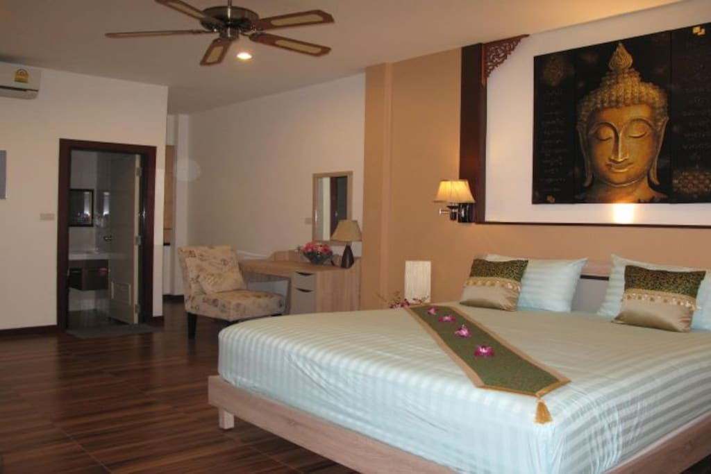 Spacious rooms with air conditioning and  overhead fan.
