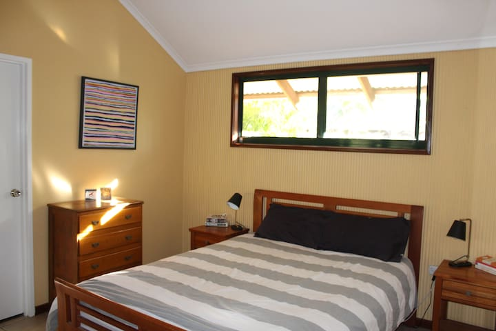 Master bedroom with queen bed and full wardrobe