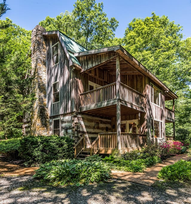 Situated on the bank of a spring fed creek and surrounded by 90 beautiful acres of natural and ever changing wooded hills