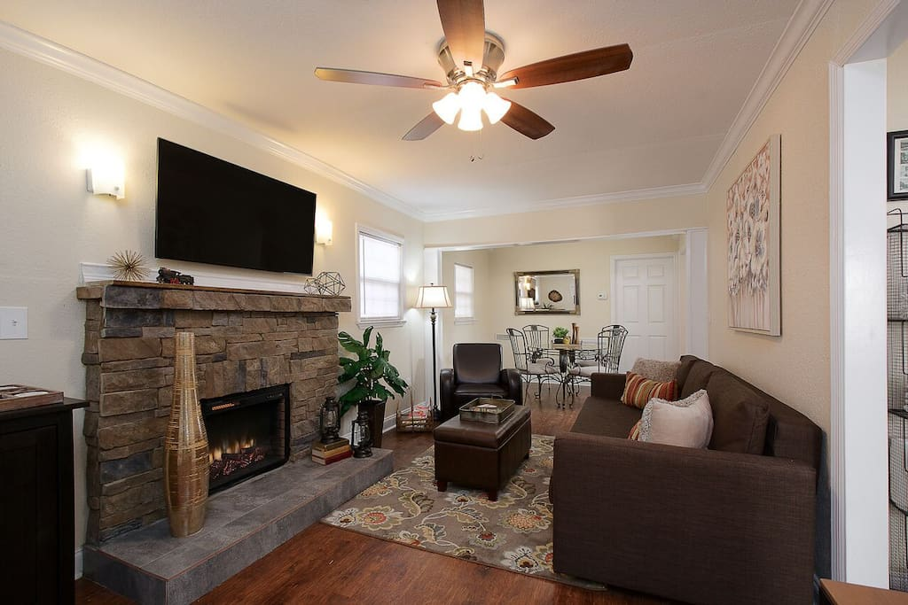 "Enjoy the electric fireplace and 48"" television in the living room."