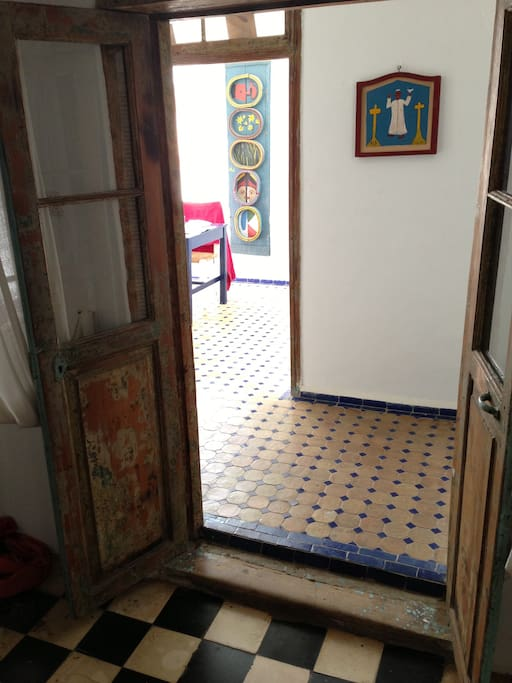 Careful renovation retaining ancient wooden door frames and windows