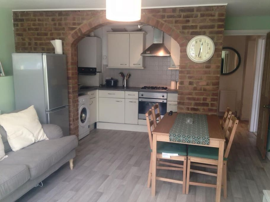Lounge area with fridge freezer and dining table