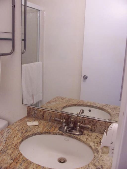 2 full bathrooms with shower and bath in each
