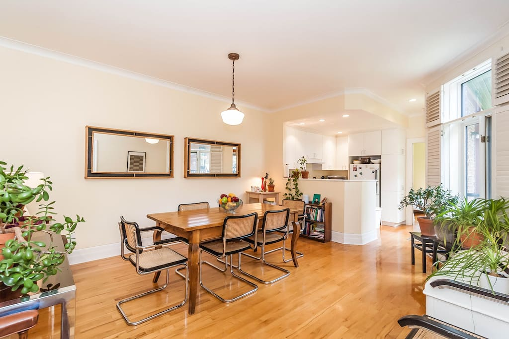 Open concept dining/kitchen. Solid wood table, seats 6-8.