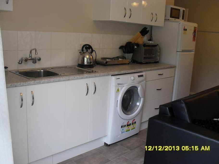 Fully equipped kitchen with bench oven, plug in hob and lots of plug in cooking equipment