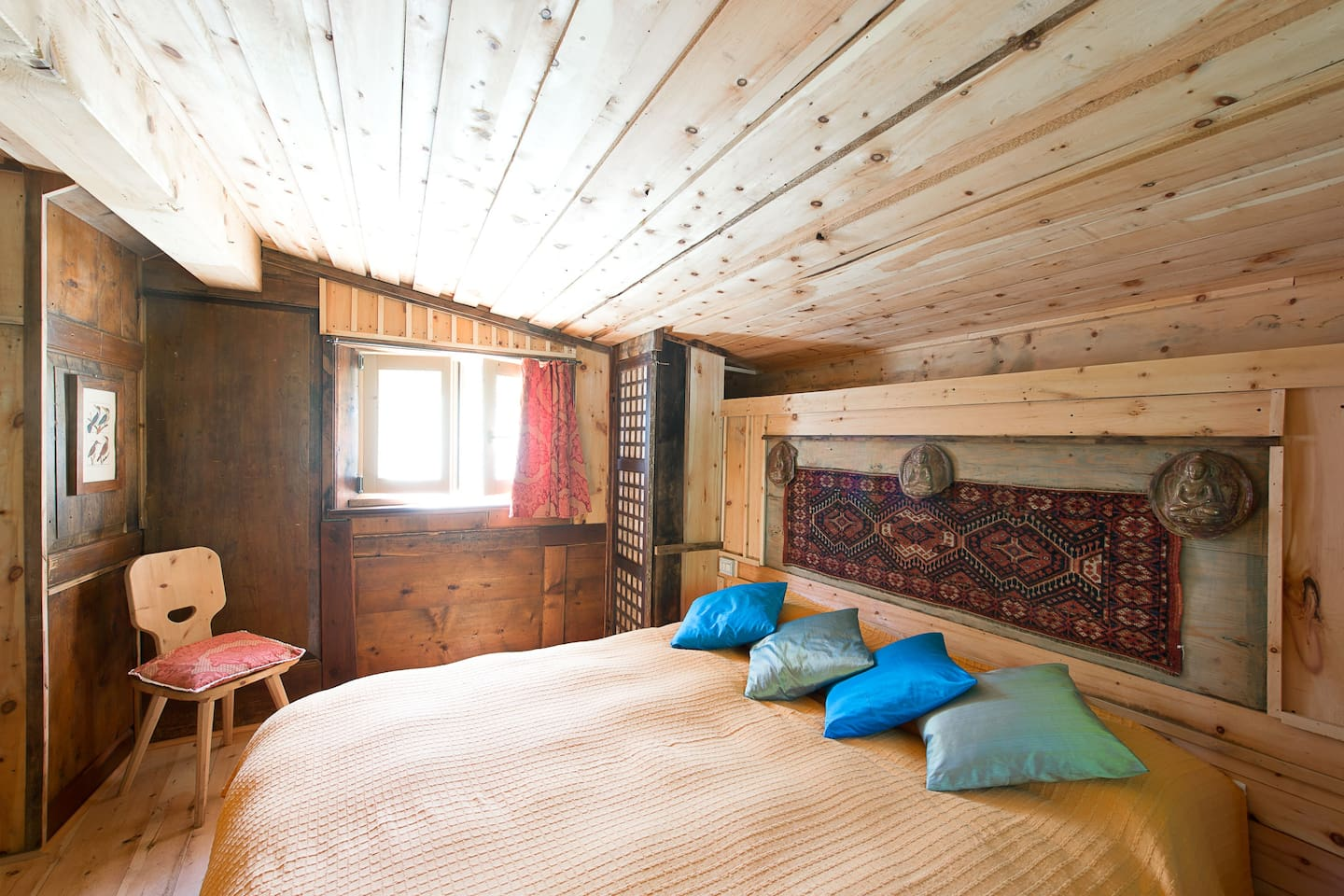 antique wood and ethnic objects have been used to furnish the guests room