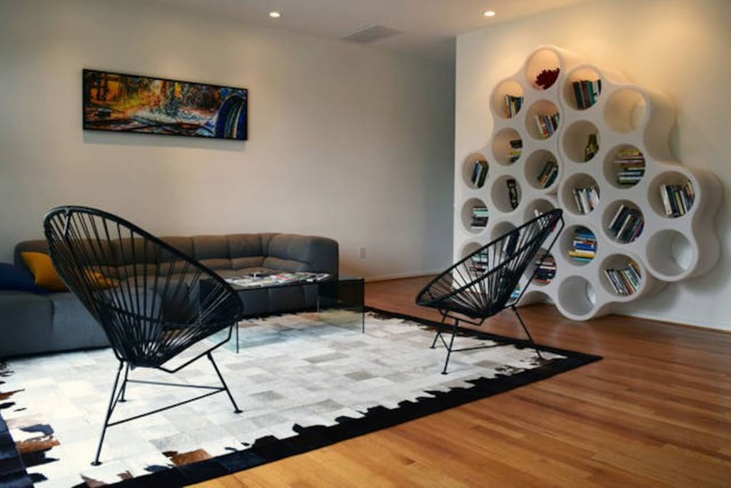 Neato living room with hip furniture that you are welcome to lay upon.
