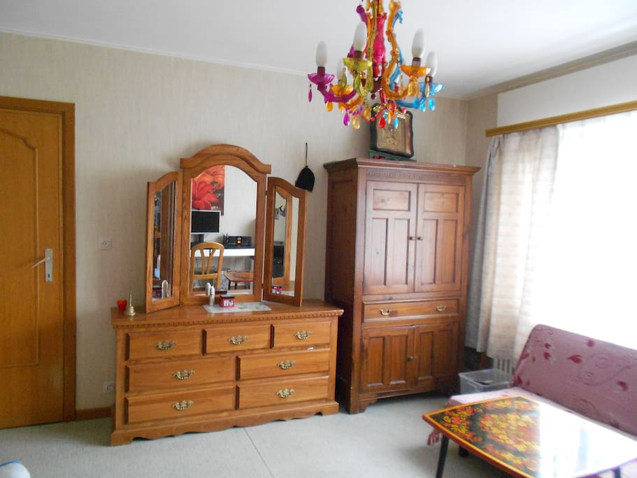 There are an oak mirror dresser and a wardrobe in the room