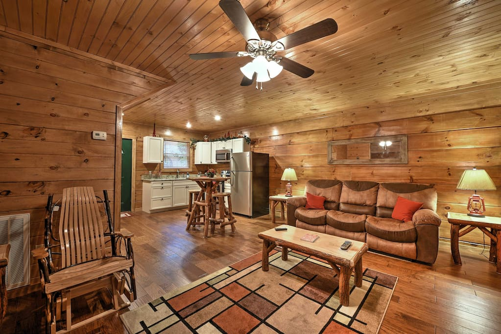 Inside, the cabin has hardwood flooring and wood ceilings and walls.