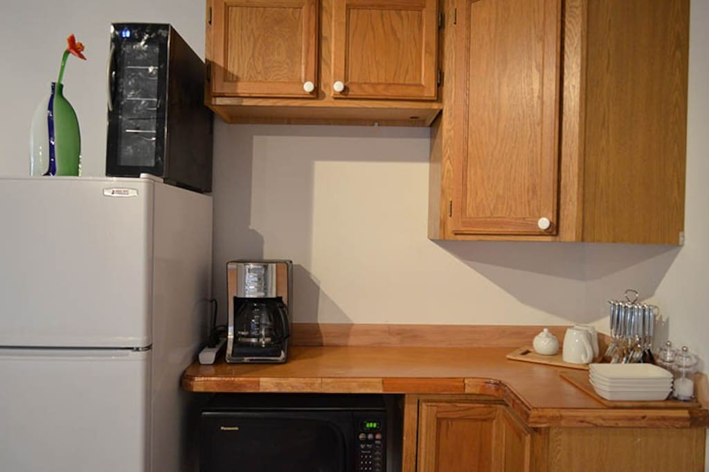 A small kitchenette provides for personal morning-coffee, tea, beverage and food storage.