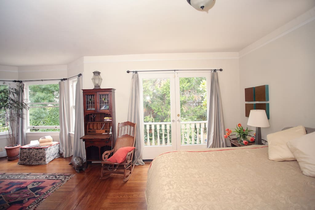 Master bedroom, king size bed with luxurious linens, garden view