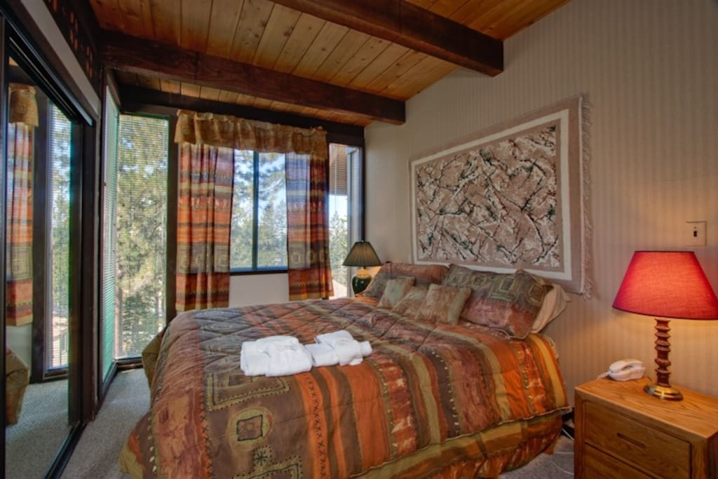 The master bedroom on the main floor has a king bed and an en-suite bathroom.