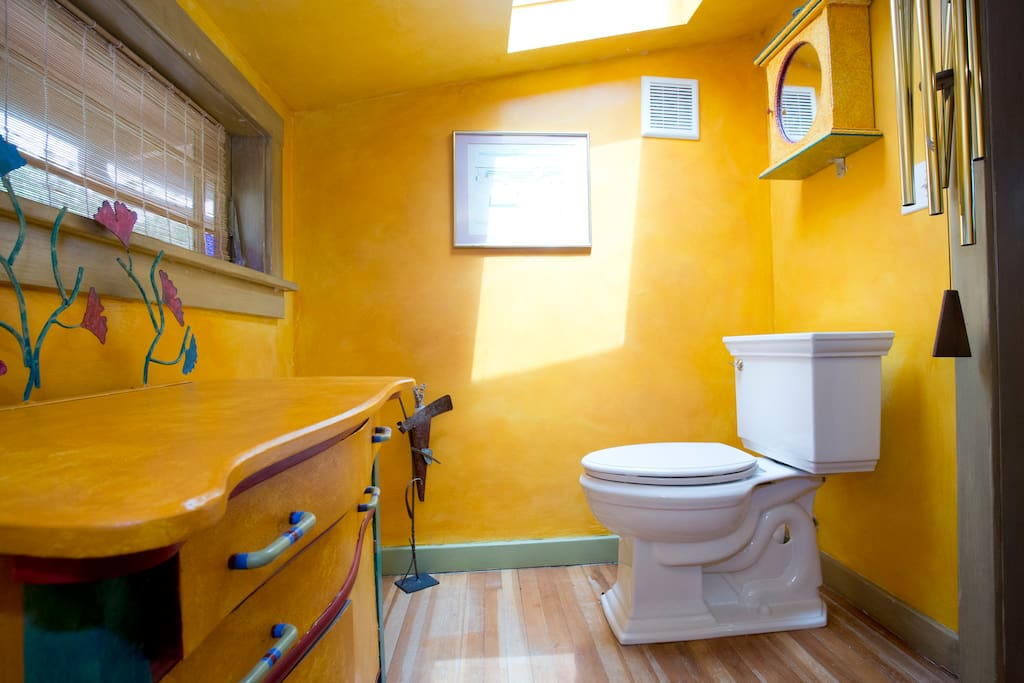 Big surprise: a toilet!!  Plus a skylight and a dormer window that looks out at giant conifers.