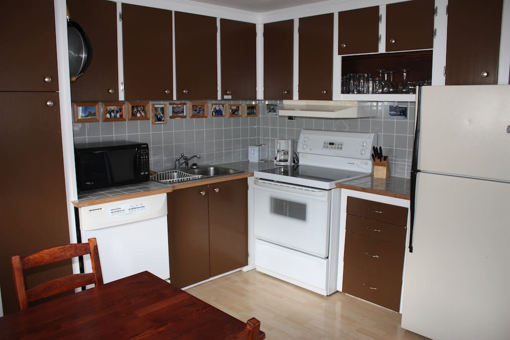 Full Kitchen with Dishwasher, Stove, Microwave, Toaster, Coffee Maker and Fridge/Freezer.