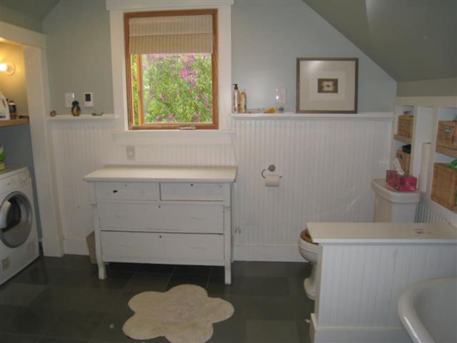Claw foot tub, separate shower, washer and dryer.
