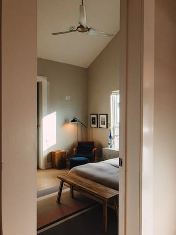 Entrance to master bedroom with smart lock, high ceilings,  and huge ceiling fan.