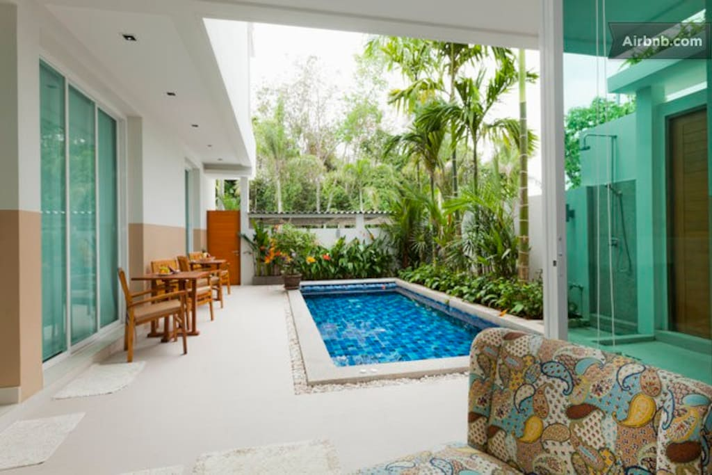 VIEW FROM THE BIG BEDROOM TO THE PRIVATE  POOL AREA ,