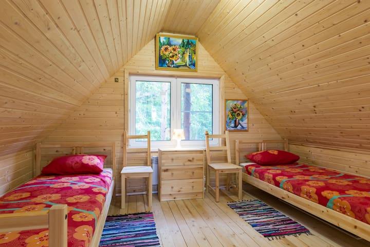 Спальня на втором этаже бани