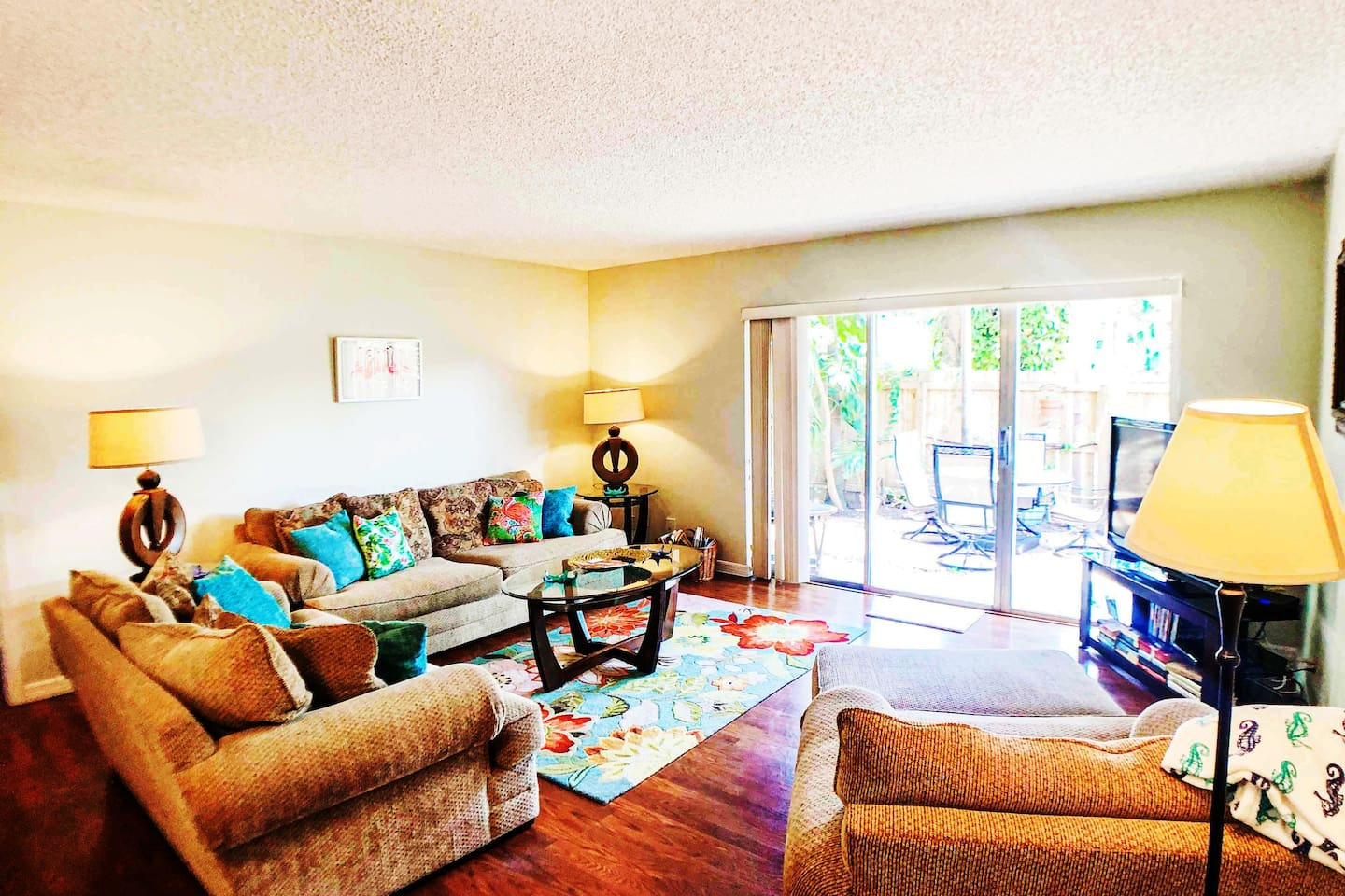 Living room with view of privet patio with gated entree to your car. We have the only patio with gated entree in the development