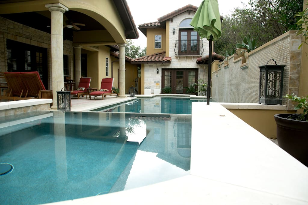 Shaded lounge area and sports pool