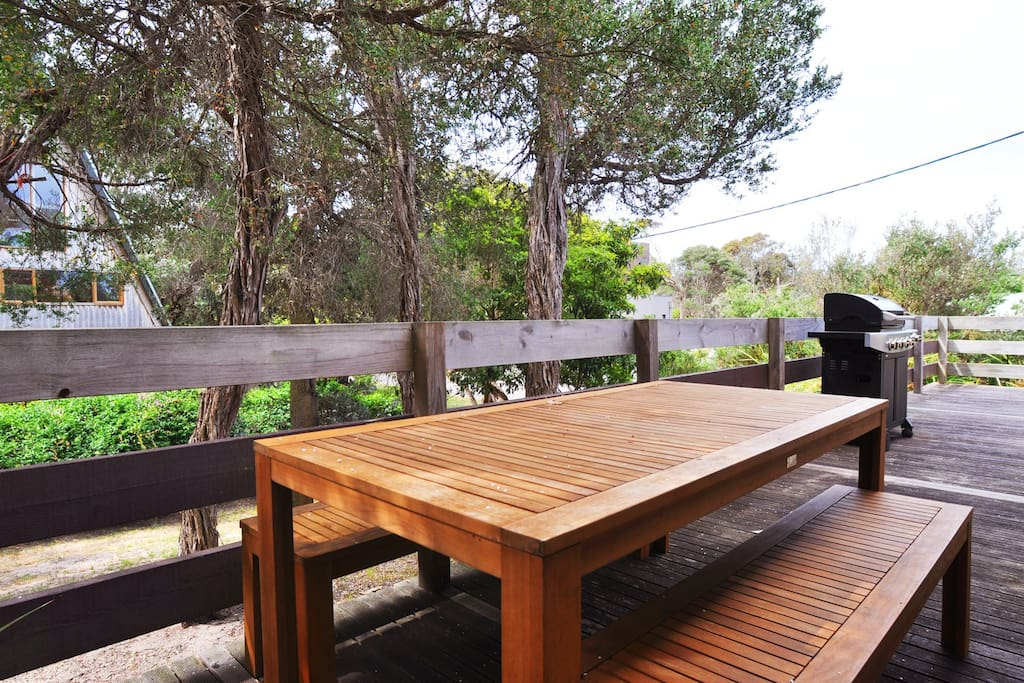 Entertain and unwind on the deck with a family bbq and large outdoor dining table