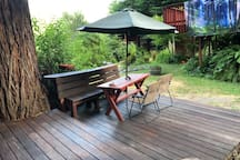 Amazing redwood deck with table.