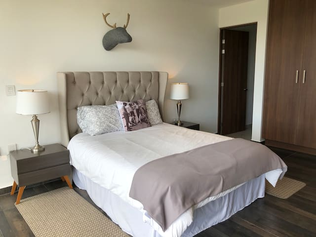 """Second bedroom has a Queen-Size bed and a sofa bed, electronic black out blinds, and one hotel-like curtains, 32"""" SmartTV with Netflix, en suite bathroom and a terrace"""