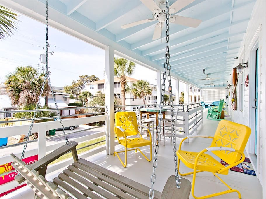 Unwind and watch the people pass by on the sunny porches
