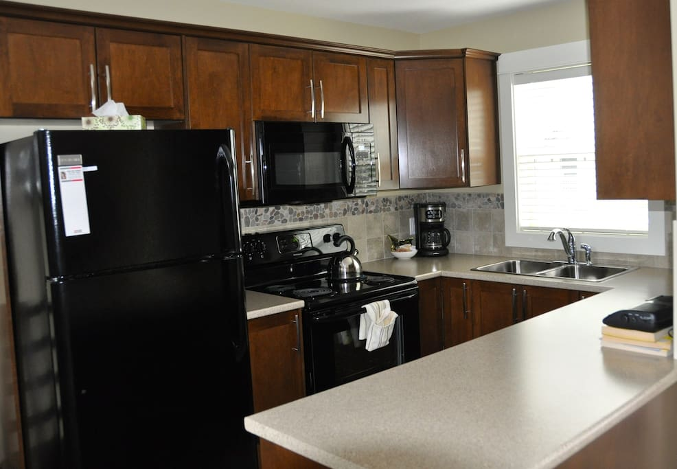 Kitchen equipped with a dishwasher and a microwave.