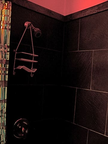 Ceramic tiled shower stall -- lots of room ... for two, even.  :)