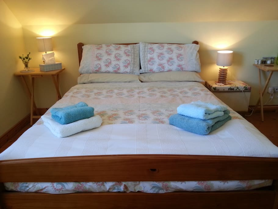 The 'Lovely' room has a comfortable double bed, fluffy towels, dressing gowns to protect your modesty when using the shared bath room and tea/coffee for a reviving drink.
