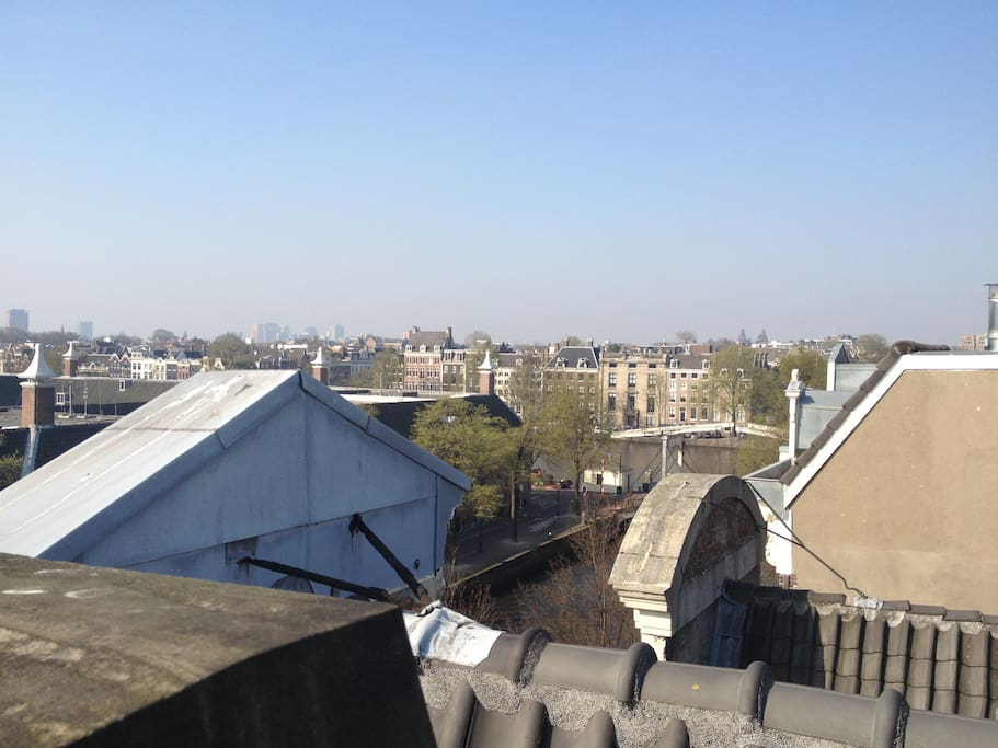 View from rooftop terrace to Amstel river and Rijks museum