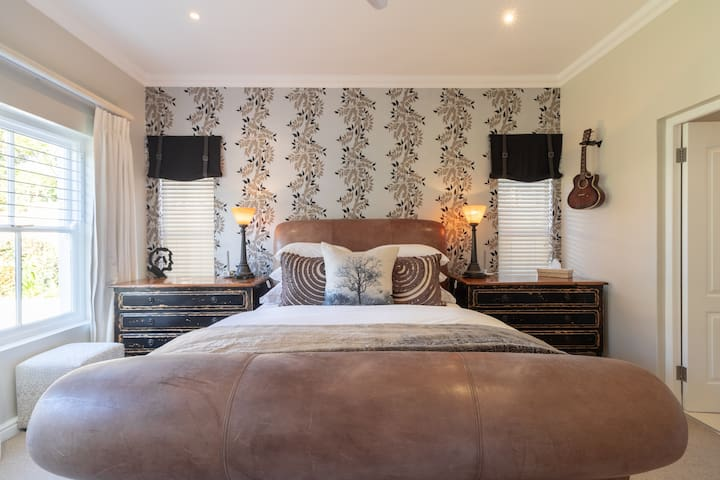 Bedroom 2. Queen size bed with ensuite bathroom with shower