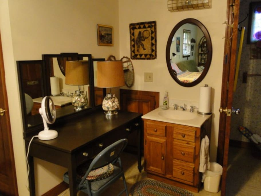 Vanity with make-up mirror and wash stand.