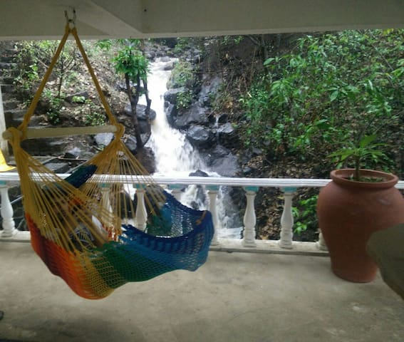 Stretch out and bond with nature in comfortable hammocks! Bar deck! The waterfall flows under the slab in the lounging area.