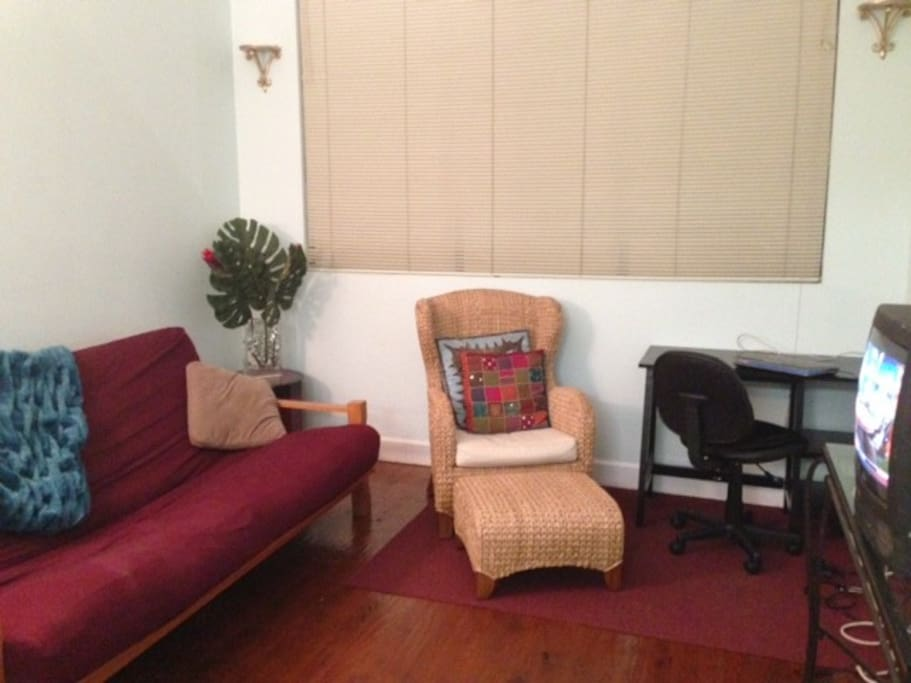 Living Room has large window looking into the atrium. There is no TV but there is WiFi...