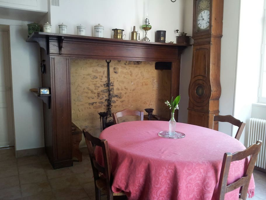 Dining room with real old style chimney (not in use)
