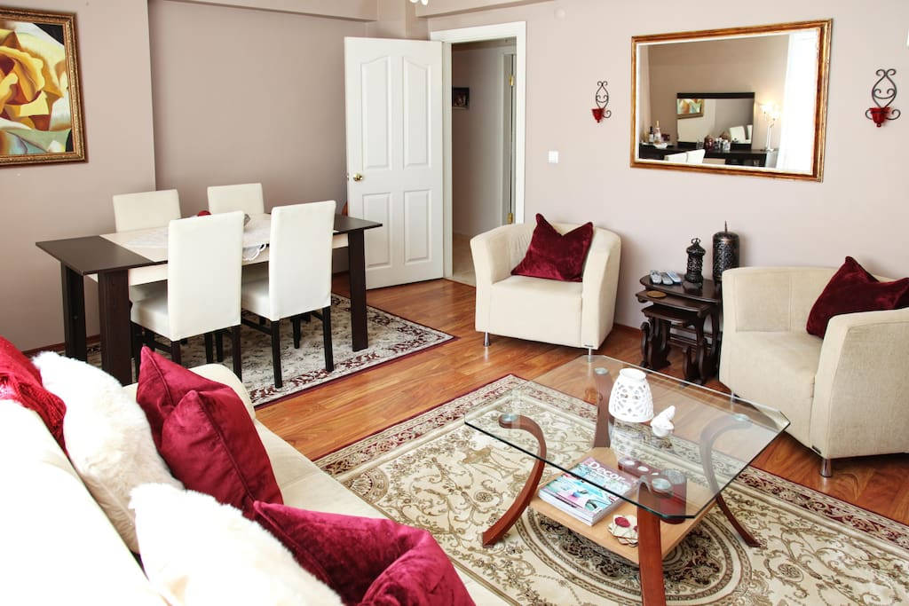 This room has been converted into a Jr. suite with a single bed and wardrobe . There is also a large L shaped sofa instead of the table and sofa's shown.
