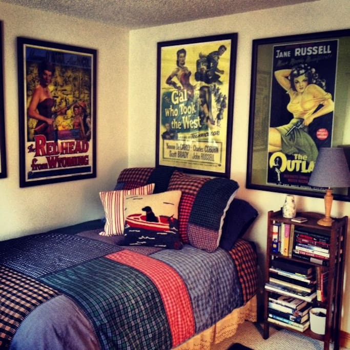 Guest Room has a full size bed, old western movie posters, lots of books, a desk, your choice of cotton or flannel sheets, down comforter and plenty of pillows