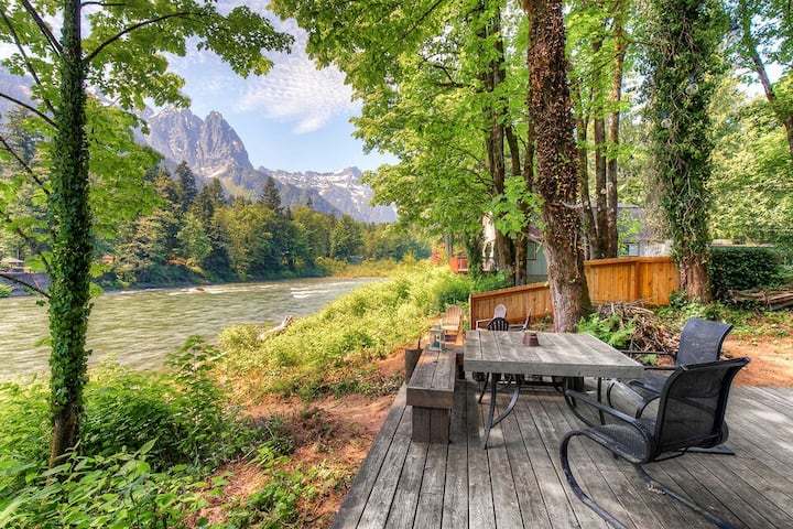 NEW! Charming riverfront home with staggering mountain views! Firepit, woodstove