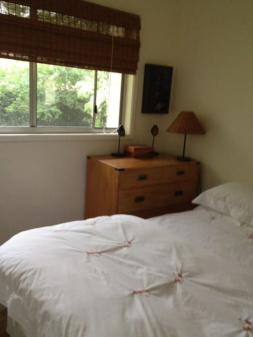 The bedroom with the window facing the back of the house