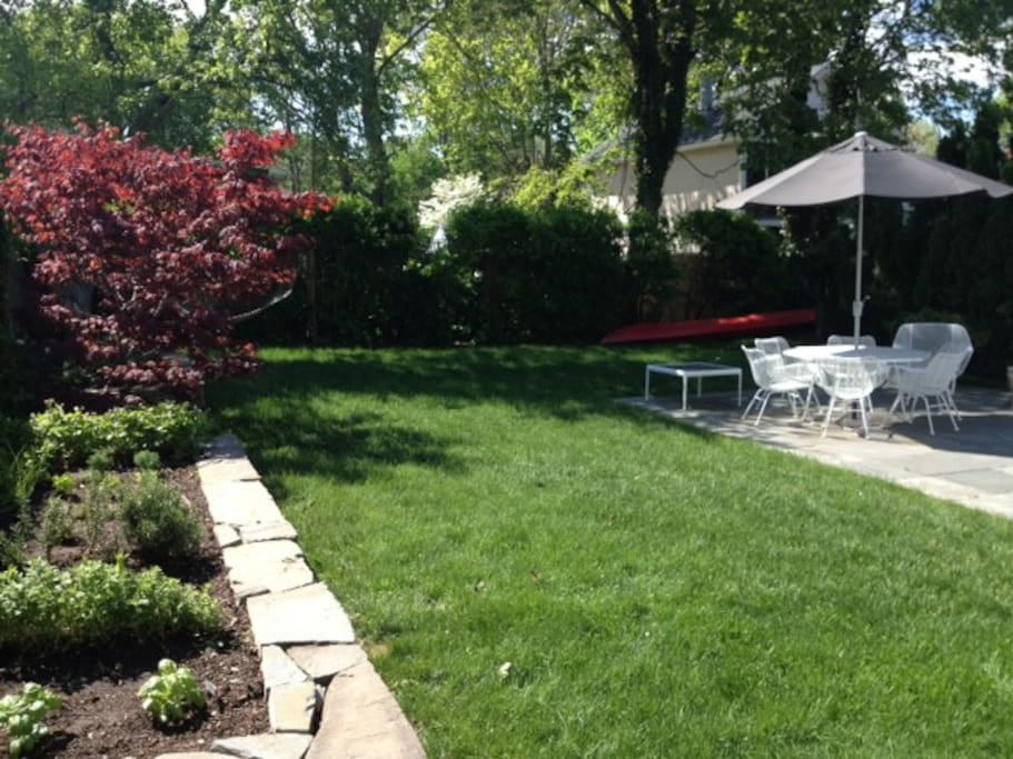 nice backyard with hammock and kayak (grill not shown)