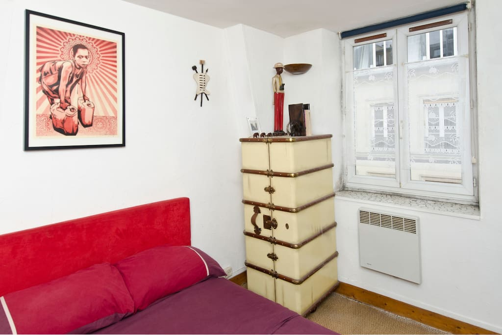 A separate bedroom with a large comfortable double bed.