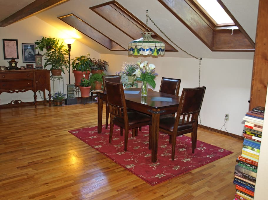 The warm wood floors of the dining room are bathed in natural light from the 3 large skylights.  It also hosts the property's loaning library.