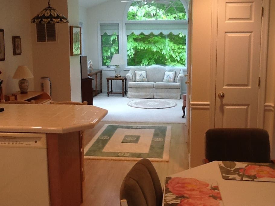 View from sit-in kitchen to sunroom