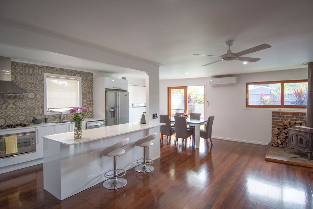 Fully equipped kitchen and open living and dining area looking out onto the pool