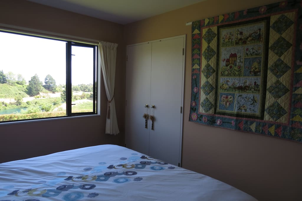 Bedroom provides views of the Waikato River.