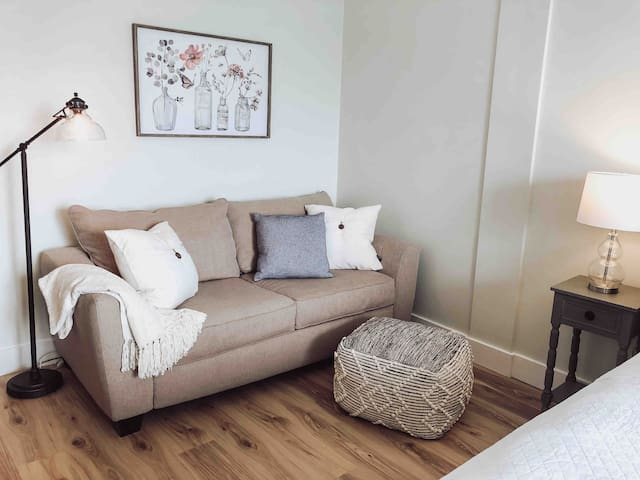 Full size sleeper sofa with memory foam mattress for added comfort.