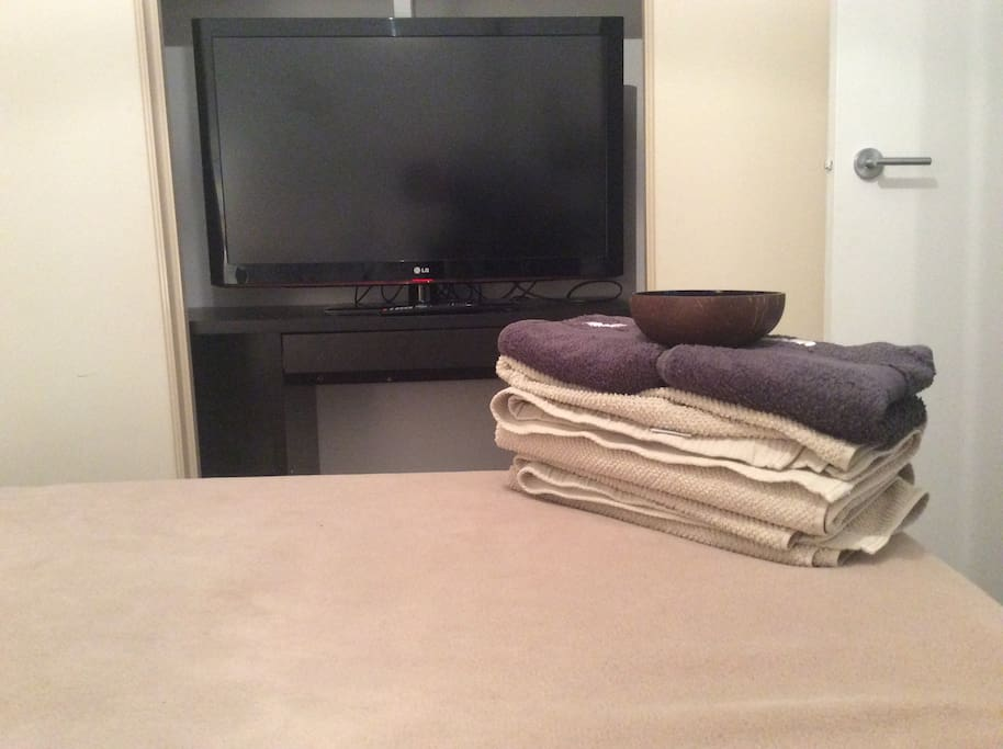 Built in robe includes a TV. Towels are also provided during your stay.